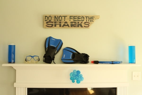 a sign on a wall that says Do Not Feed the Sharks