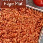 overhead view of a square serving dish filled with tomato bulgur pilaf