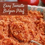 closeup of a scoop of tomato bulgur pilaf in a colorful dish