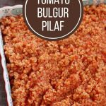 bright red tomato bulgur pilaf in a colorful square serving dish