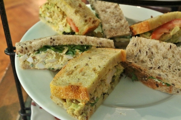 a variety of sandwich halves on a white plate