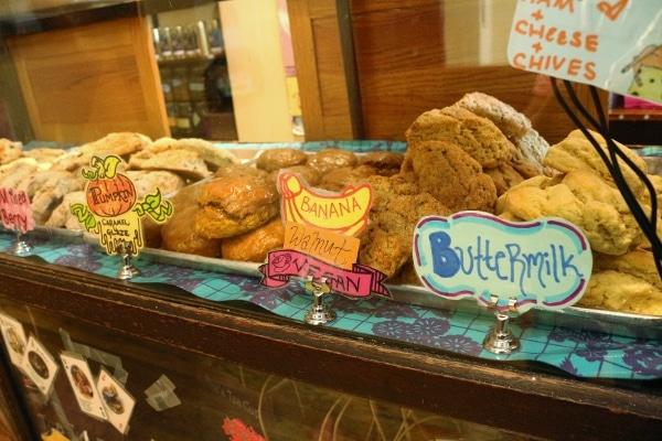 A closeup of a store display of scones