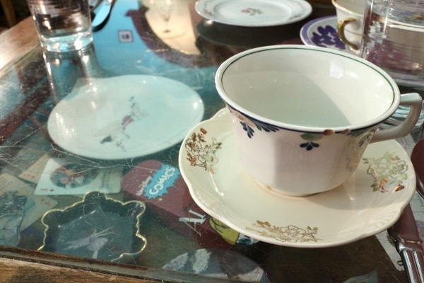 A teacup and saucer on a colorful table