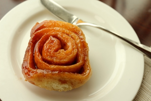 a sticky bun on a small white plate