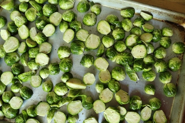 uncooked brussels sprouts on a metal baking sheet