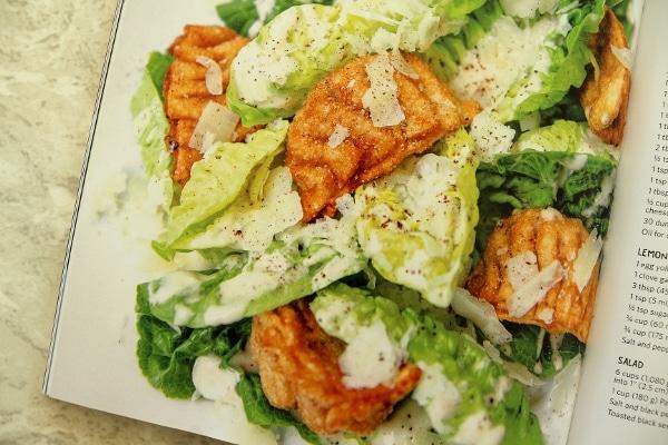 fried dumplings served over a Caesar salad