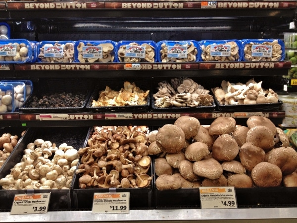 A store display of various mushrooms for sale