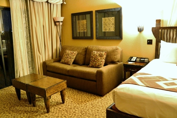 a small sofa and coffee table in a hotel room
