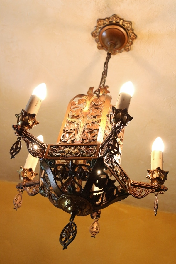 a metal chandelier hanging from the ceiling