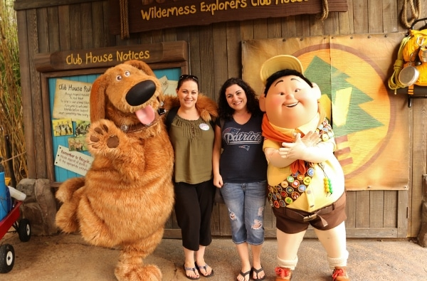 two women posing with Dug and Russell from Disney\'s Up! movie