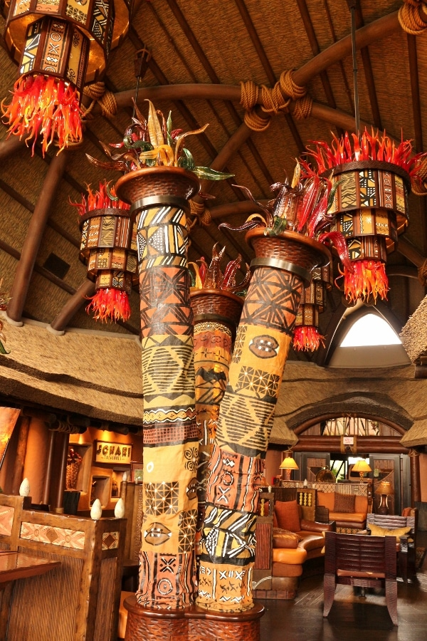 tall colorful totem looking structures inside the Animal Kingdom Villas lobby