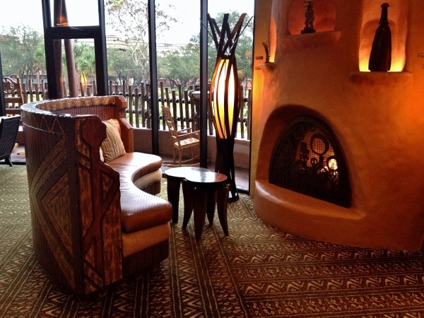 a lounge area with a small fireplace