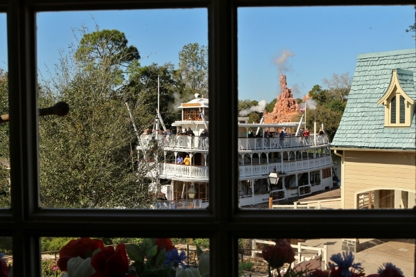 view looking out the window at a riverboat