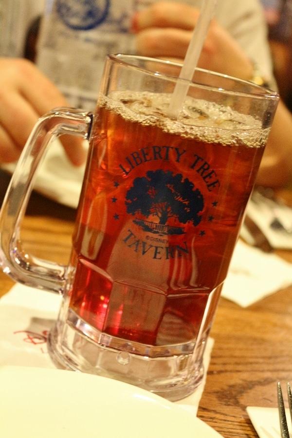 A glass mug that says Liberty Tree Tavern on a table