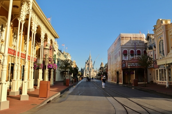 view looking down a mostly empty Main Street USA toward Cinderella Castle