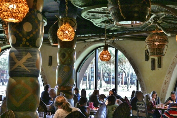 interior of a busy restaurant with hanging lights and colorful columns