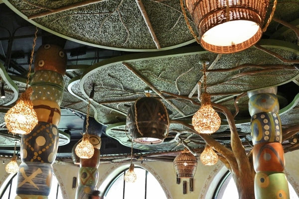 a restaurant ceiling that resembles a tree canopy with hanging lights