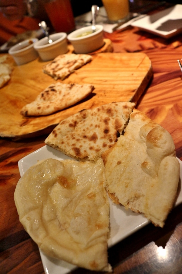 a variety of Indian and African breads served on a plate