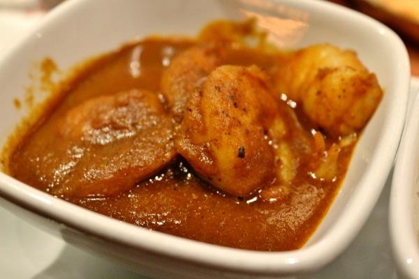 a closeup of a bowl of shrimp curry
