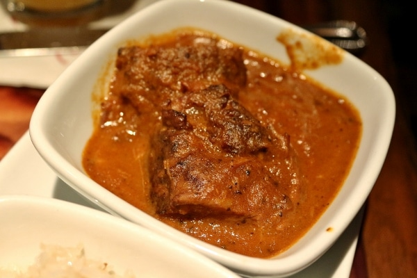 a closeup of a bowl of beef short rib in curry sauce