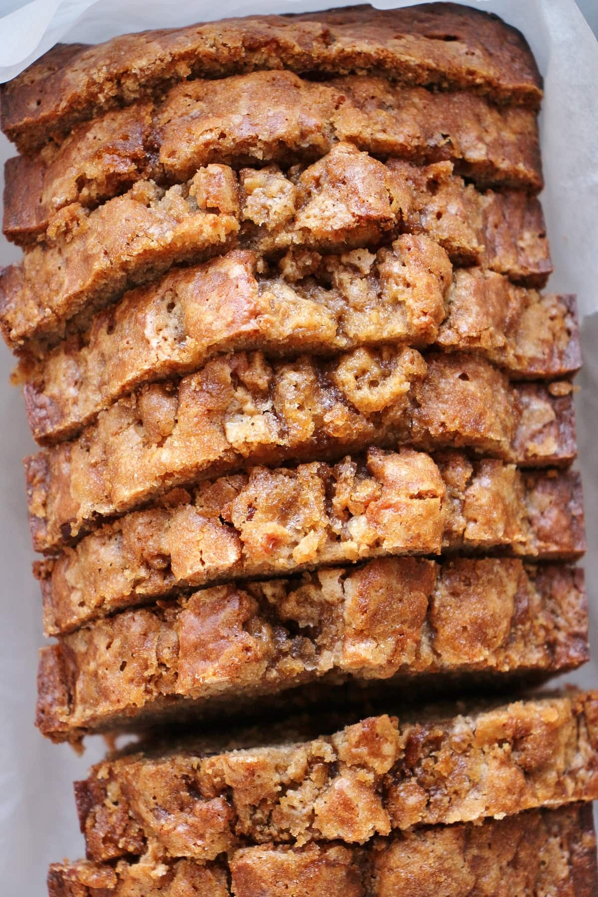 Closeup of a sliced loaf of banana bread.