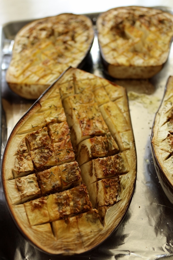 scored eggplant halves roasted in the oven