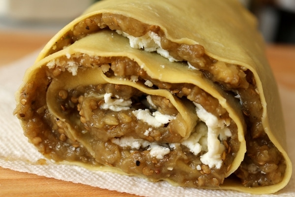 a side view of an assembled eggplant and cheese roll-up