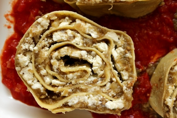 overhead view of eggplant and cheese pasta roll-ups in a baking dish