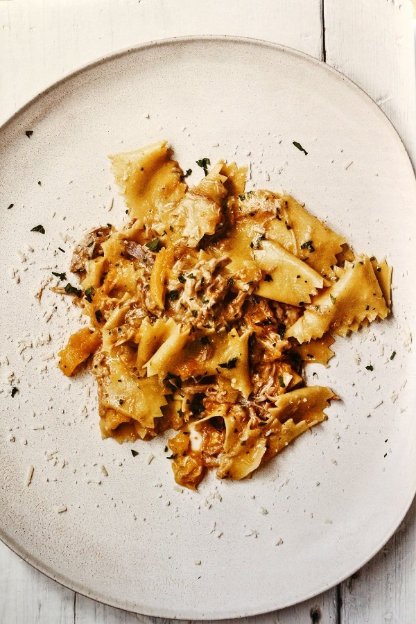 A plate of pasta with meat ragu