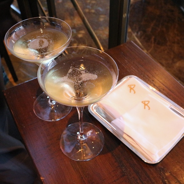 two glasses of Champagne on a wooden table