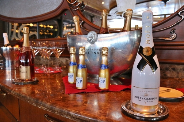 a table with various bottles of Champagne in different sizes