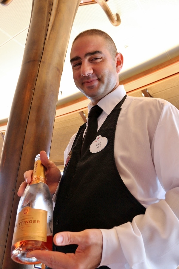 A man holding a bottle of Champagne