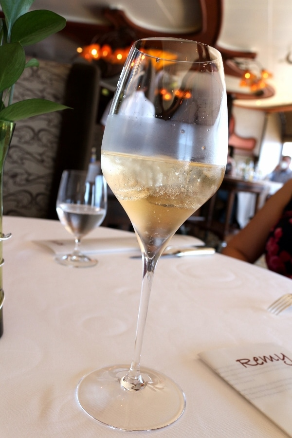 a glass of chilled Champagne served with ice