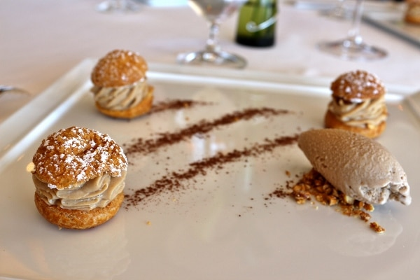 a plate of small cream puffs