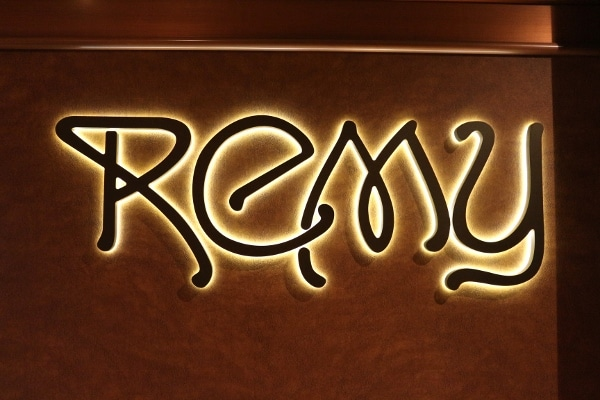 a lit up sign that says Remy