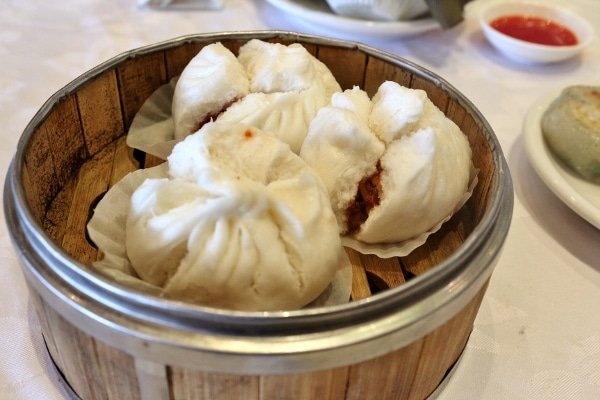 steamed Chinese buns in a bamboo steamer basket