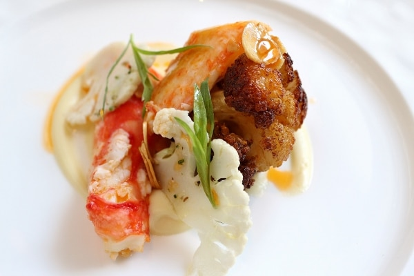 an artful plate of food featuring crab meat and cauliflower