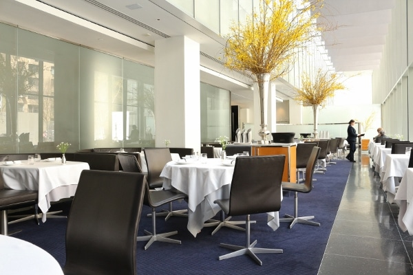 interior of a contemporary restaurant dining room with tall ceilings