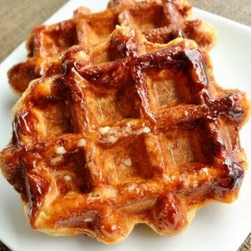 a closeup of Belgian Liège waffles on a white plate