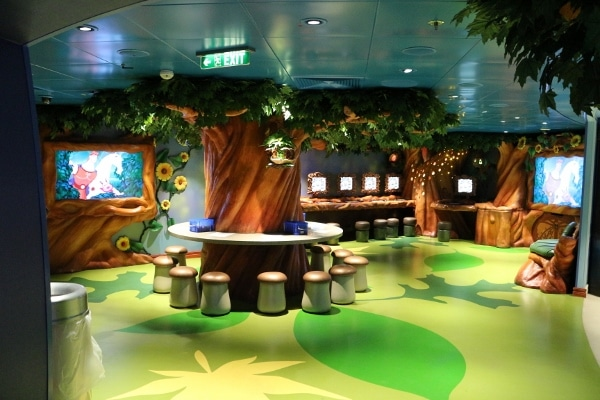 a room in the kid\'s club themed like a forest with leaves and flowers