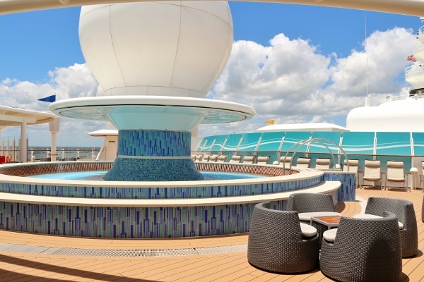Satellite Falls on the Disney Fantasy with a pool area and outdoor seating