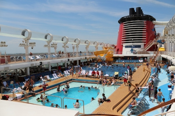 the crowded pool deck of the Disney Fantasy cruise ship
