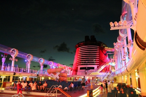 a view of the Disney Fantasy\'s pool deck at night