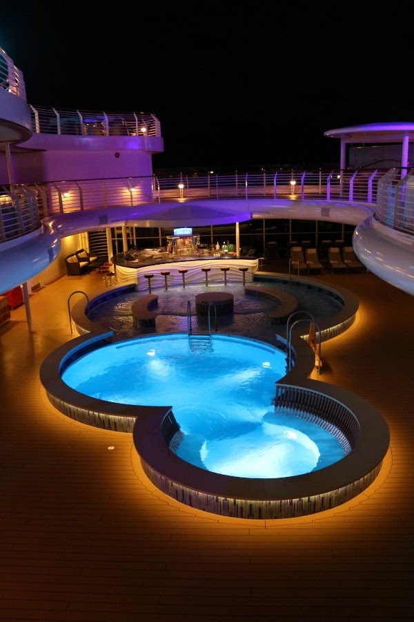 the empty Quiet Cove pool on the Disney Fantasy cruise ship at night
