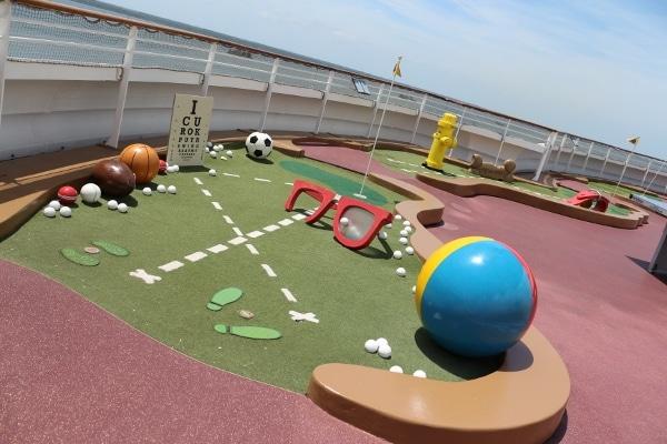 a mini golf course on a cruise ship outdoor deck