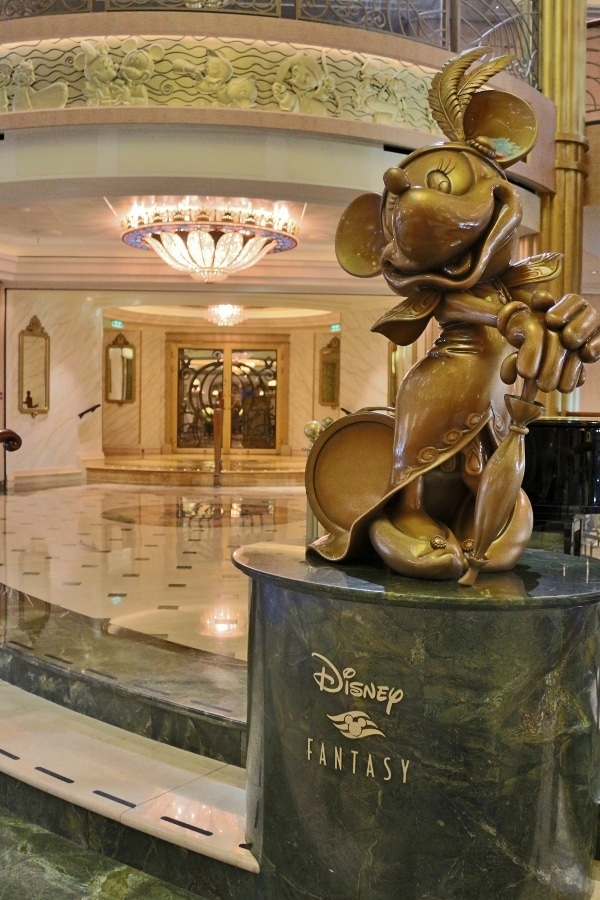 a closeup of a Minnie Mouse statue in the Disney Fantasy lobby