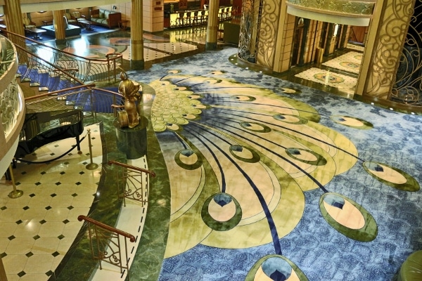 a view of the peacock themed carpeting in the Disney Fantasy lobby