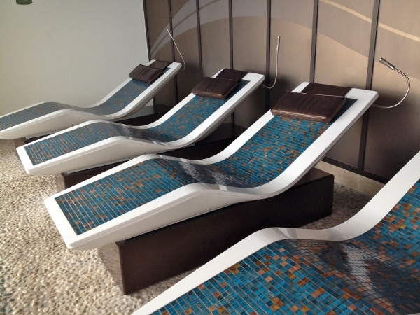 a row of tiled lounge chairs in the Rainforest Room