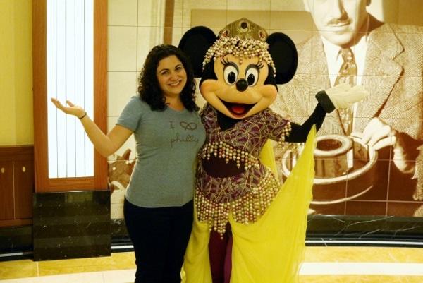 a woman posing with Minnie Mouse dressed like Princess Jasmine