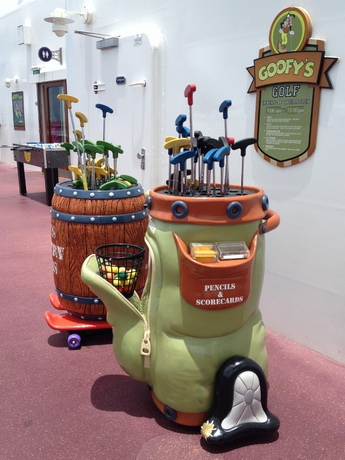 golf bag shaped containers filled with mini golf clubs